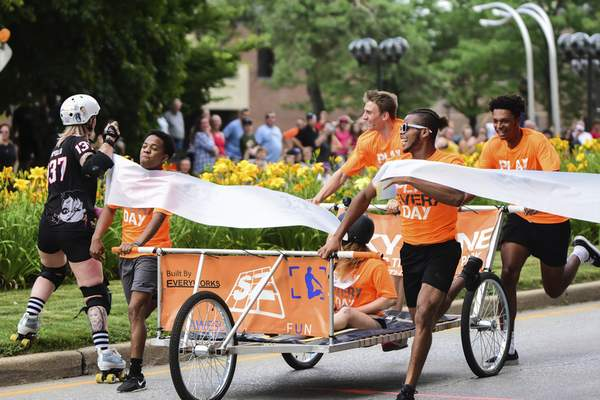 Mike Moore | The Journal Gazette Team Sky Zone crosses the finish line while racing in the Three Rivers Festival Bed Race on Main Street downtown on Wednesday.