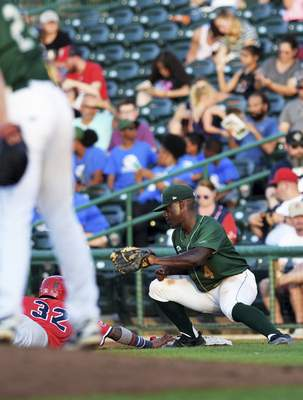 Katie Fyfe | The Journal Gazette TinCaps' Lee Solomon attempts to get Chief's Delvin Perez out at second base during the fourth inning at Parkview Field on Thursday.