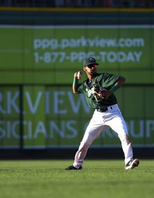 Katie Fyfe | The Journal Gazette TinCaps' Tucupita Marcano passes the ball during the second inning against the Chiefs at Parkview Field on Thursday.