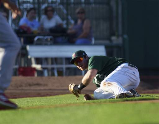 Katie Fyfe | The Journal Gazette TinCaps' Luke Becker slides to catch the ball during the first inning against the Chiefs at Parkview Field on Thursday.