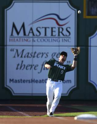 Katie Fyfe | The Journal Gazette TinCaps' Luke Becker catches the ball during the first inning against the Chiefs at Parkview Field on Thursday.