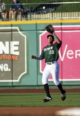 Katie Fyfe | The Journal Gazette TinCaps' Agustin Ruiz catches the ball during the second inning against the Chiefs at Parkview Field on Thursday.