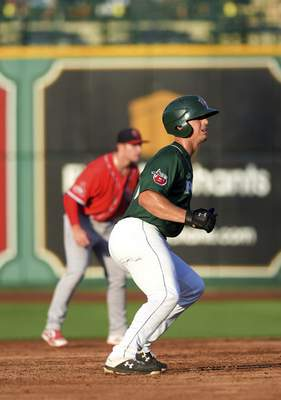 Katie Fyfe | The Journal Gazette TinCaps' Michael Curry prepares to run to third base during the third inning against the Chiefs at Parkview Field on Thursday.