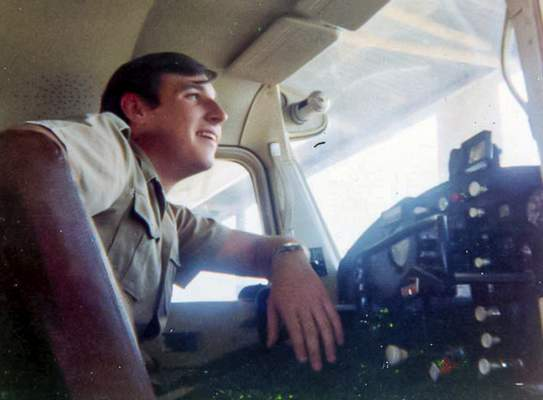 This 1971 photo provided by David Waldrup shows him in the cockpit of a Cessna 172 at White Rock airport in Dallas. The day of the moon landing on July 20, 1969, David was celebrating not only man's first steps on the moon - he was also celebrating his 15th birthday. (Courtesy David Waldrup via AP)