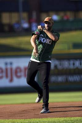 "Producer and personality of ESPN hit talk show ""The Dan Le Batard Show with Stugotz"" Michael Ryan Ruiz pitches the ball before the TinCaps vs. Chiefs at Parkview Field on Thursday."