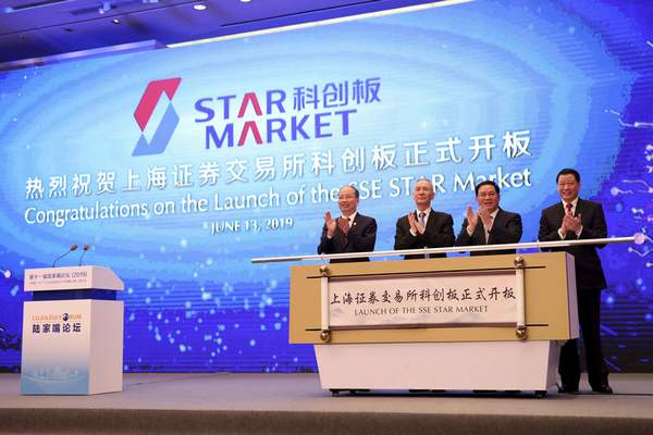 Associated Press  Guests, from left, Yi Huiman, chairman of China Securities Regulatory Commission, Liu He, vice premier, Li Qiang, top party official of Shanghai, and Ying Yong, Shanghai's mayor, celebrate the launch of the SSE STAR Market on Monday.