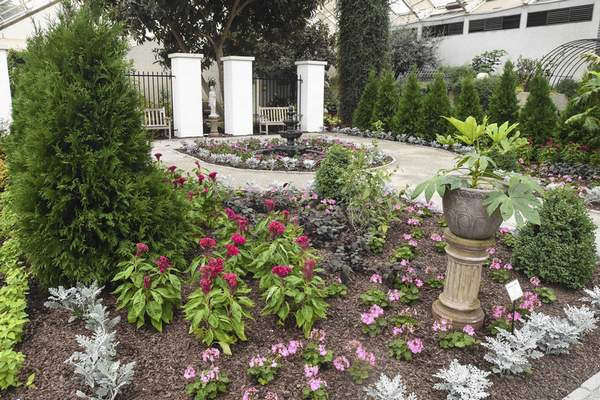 Photos by Michelle Davies   The Journal Gazette A replica of a wealthy gentleman's formal garden, showcasing plants collected by plant hunters, is part of Foellinger-Freimann Botanical Conservatory's newest exhibit.