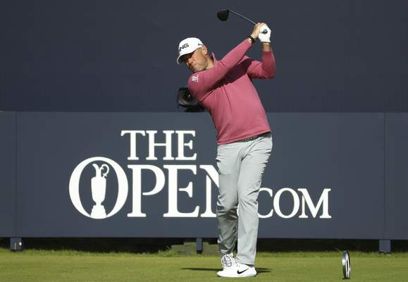 England's Lee Westwood plays his tee shot on the 1st during the second round of the British Open Golf Championships at Royal Portrush in Northern Ireland, Friday, July 19, 2019.(AP Photo/Peter Morrison)