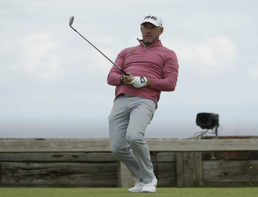 England's Lee Westwood reacts to his tee shot on the 6th during the second round of the British Open Golf Championships at Royal Portrush in Northern Ireland, Friday, July 19, 2019.(AP Photo/Matt Dunham)