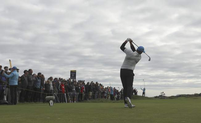 Brooks Koepka of the United States plays his tee shot on the 4th hole during the second round of the British Open Golf Championships at Royal Portrush in Northern Ireland, Friday, July 19, 2019.(AP Photo/Jon Super)