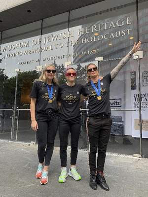 Jeff Simmons via Associated Press: In this July 10 photo provided by Jeff Simmons, U.S. women's soccer player Ashlyn Harris raises her left arm next to  teammates Allie Long and Megan Rapinoe outside the Museum of Jewish Heritage in New York City. The photo was taken before a victory parade to celebrate the team's Women's World Cup title. Stories circulating online incorrectly asserted that Harris is giving a Nazi salute.