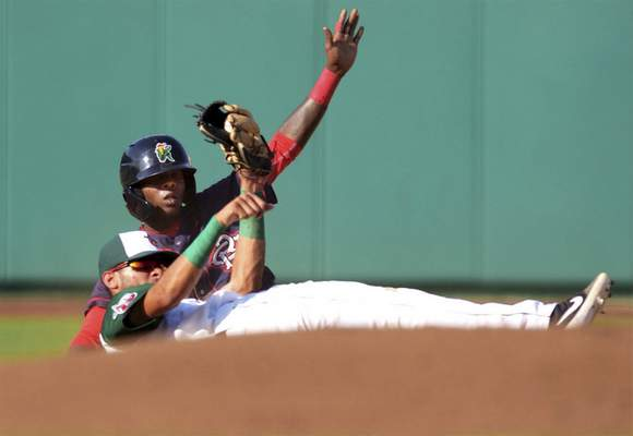 Katie Fyfe | The Journal Gazette  TinCaps shortstop Tucupita MarcanocatchesCedar Rapids' Daniel Ozoria stealing at second basewith a nifty swipe tag. The TinCaps lost 6-4 at Parkview Field.