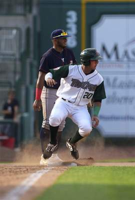 Katie Fyfe | The Journal Gazette TinCaps' Agustin Ruiz slides into third base during the fourth inning against the Cedar Rapids Kernels at Parkview Field on Saturday.