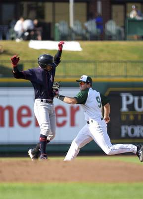 Katie Fyfe | The Journal Gazette Fort Wayne's Luke Becker, right, tags out Cedar Rapids Kernels' Gilberto Celestino during the first inning Saturday at Parkview Field.