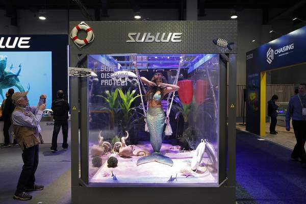 Associated Press  A woman dressed as a mermaid performs at the Sublue booth at CES International in Las Vegas this year. The group that organizes the annual CES gadget show is cracking down on its dress code.