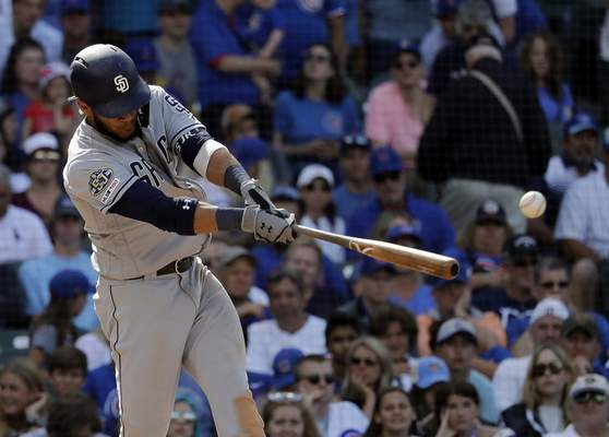 San Diego Padres' Fernando Tatis Jr. hits a two-run single during the ninth inning of a baseball game against the Chicago Cubs in Chicago, Sunday, July 21, 2019. (AP Photo/Nam Y. Huh)