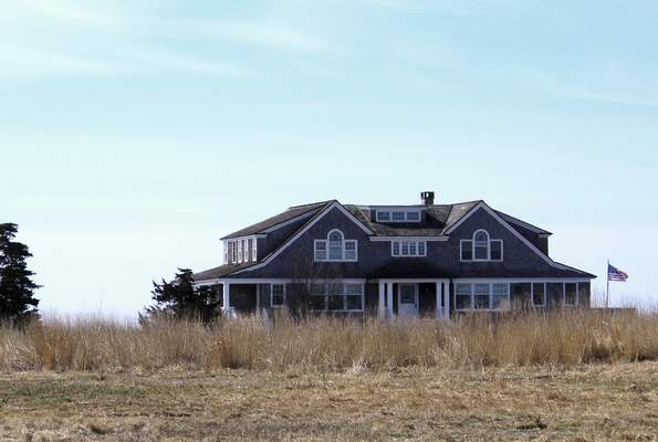 In this April 2, 2019 photo, a multimillion-dollar home sits on a peninsula in Old Saybrook, Conn. (AP Photo/Dave Collins)
