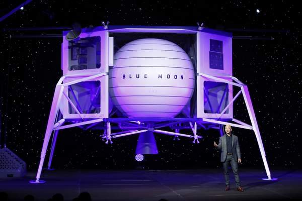 FILE - In this, May 9, 2019, file photo, Jeff Bezos speaks in front of a model of Blue Origin's Blue Moon lunar lander in Washington. (AP Photo/Patrick Semansky, File)