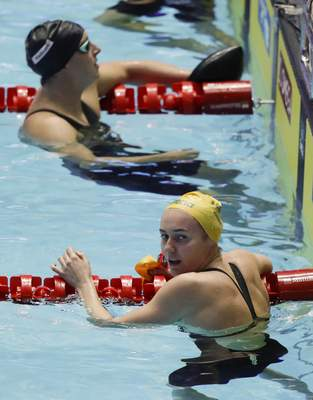 Australia's Ariane Titmus, front, reacts after winning the women's 400m freestyle final at the World Swimming Championships in Gwangju, South Korea, Sunday, July 21, 2019. (AP Photo/Mark Schiefelbein)