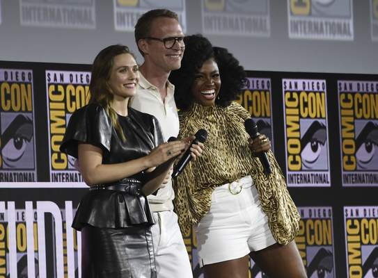 Elizabeth Olsen, from left, Paul Bettany and Teyonah Parris participate in the