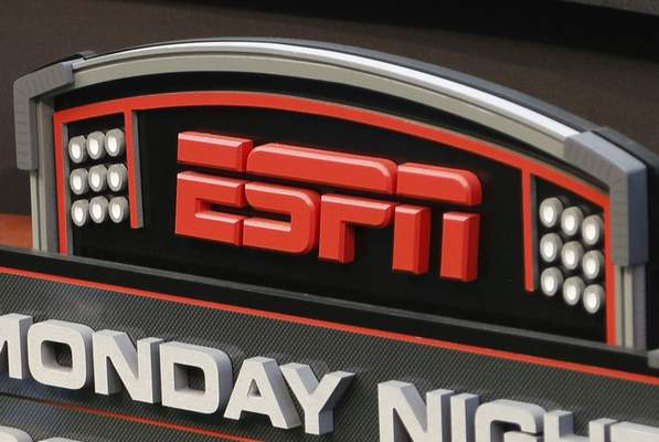 FILE - This Sept. 16, 2013, file photo shows the ESPN logo prior to an NFL football game between the Cincinnati Bengals and the Pittsburgh Steelers, in Cincinnati. (AP Photo/David Kohl, File)