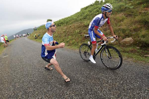 Associated Press A spectator cheers France's Thibaut Pinot during the 15th stage of the Tour de France on Sunday. The 115-mile stage finished with a mountain climb to  Prat d'Albis. Pinot finished second in the stage.