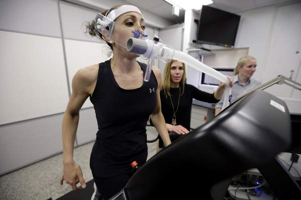 Associated Press  Research scientist Leila Walker, left, and nutritional physiologist Holly McClung, center,  demonstrate equipment designed to evaluate fitness levels in female soldiers who have joined elite fighting units at the U.S. Army Research Institute of Environmental Medicine.
