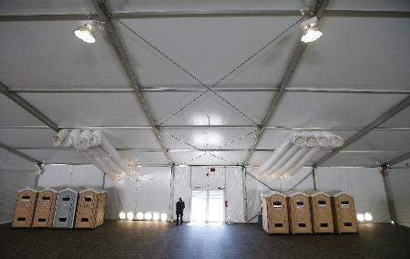 Associated Press: This June 28, 2019, file photo shows part of a new 500-person tent facility during a media tour by the U.S. Border Patrol in Yuma, Ariz. It will be used to process detained immigrant children and families who cross the U.S. border. On Friday, the Associated Press reported on stories circulating online incorrectly asserting that detained migrants are free to leave detention centers at any time to go back to Mexico.