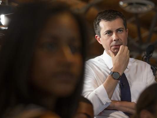 Democratic presidential candidate and South Bend, Ind., Mayor Pete Buttigieg listens to