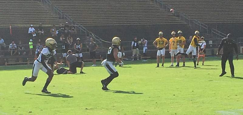 Purdue quarterback Elijah Sindelar throws to wide receiver Jackson Anthrop (right), who is defended by cornerback Cory Trice during team drills at Purdue's fall camp practice at Ross-Ade Stadium on Thursday. (Dylan Sinn)
