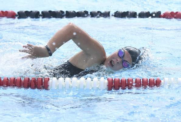 Michelle Davies | The Journal Gazette Cali Prochaska, a member of Blackhawk Swim Club, warms up with laps during Monday morning's practice.