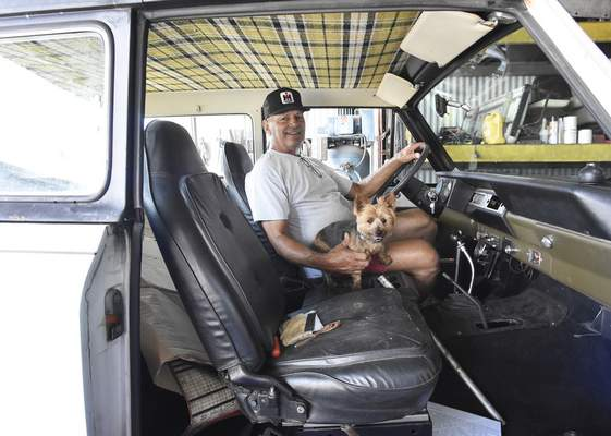 Rachel Von Stroup | The Journal Gazette Sam Elliot and his dog Sassy pose for a photo with his 1978 The Sunriser prototype at his home in Roanoke, IN on Tuesday July 30, 2019. Sam Elliot has six vehicles he will display at the Aug. 10 Harvester Homecoming in Fort Wayne.