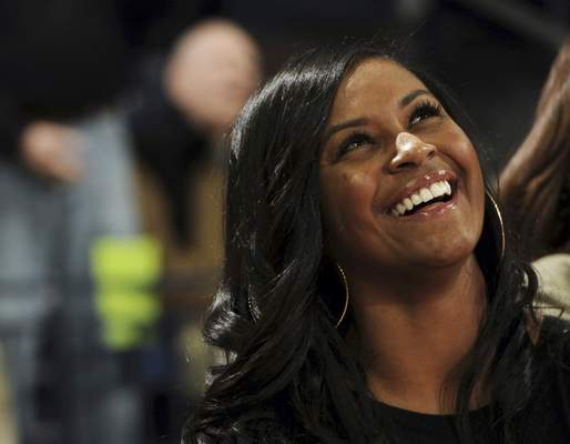 FILE - In this Nov. 17, 2011, file photo, Notre Dame assistant coach Niele Ivey smiles during a presentation prior to an NCAA college basketball game against Hartford in South Bend. Ind. The Memphis Grizzlies announced Monday, Aug. 5, 2019, that they have hired former Notre Dame women's associate head coach Niele Ivey among the new assistants for coach Taylor Jenkins. (AP Photo/Joe Raymond, File)