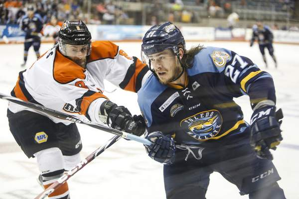 File photo  There is at least the possibility that A.J. Jenks, right, joins the Komets this season.