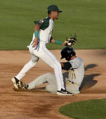 Rachel Von Stroup | The Journal Gazette  Miguel Hernandez of Dayton is called safe despite the tag being put on by TinCaps' second baseman Tucupita Marcano on a disputed play  during the third inning at Parkview Field on Wednesday night.