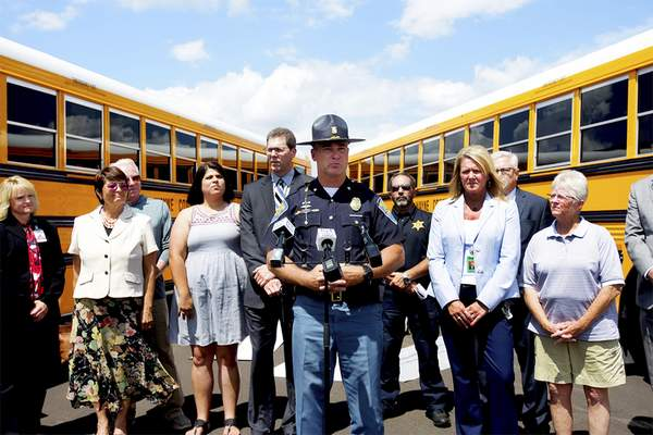 Sgt. Brian Walker of the Indiana State Police speaks Wednesday about the school bus safety campaign launched by school districts in Allen County and Parkview Health Trauma Services. (Photos by Katie Fyfe | The Journal Gazette)