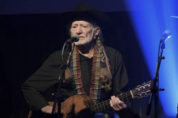 In this Feb. 6, 2019 file photo, Willie Nelson performs at the Producers & Engineers Wing 12th Annual GRAMMY Week Celebration at the Village Studio in Los Angeles. (Photo by Richard Shotwell/Invision/AP, File)