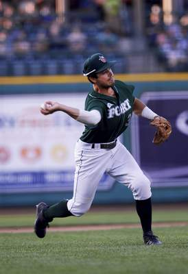 Katie Fyfe | The Journal Gazette  The TinCaps' Ethan Skender throws the ball to first base during the fourth inning against the Dayton Dragons at Parkview Field on Thursday.