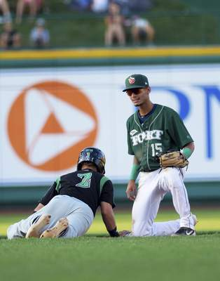 Katie Fyfe | The Journal Gazette  TinCaps' Tucupita Marcano tries to tag the Dayton Dragons' Claudio Final out at second base during the fourth inning at Parkview Field on Thursday.