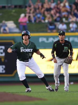 Katie Fyfe | The Journal Gazette  The TinCaps' Michael Curry prepares to run to third base during the fourth inning against the Dayton Dragons at Parkview Field on Thursday.