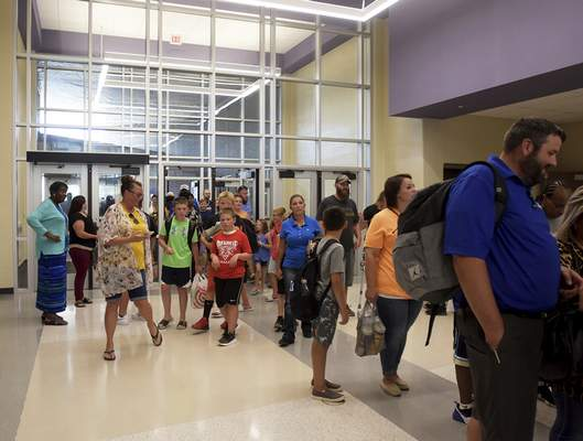 Students and parents explore the new New Haven Intermediate School during parents night Thursday. Classes at the new building start Monday. (Katie Fyfe | The Journal Gazette)