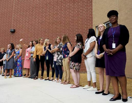 East Allen County Schools staff and board members line up along the outside of New Haven Intermediate School on Thursday. (Katie Fyfe | The Journal Gazette)