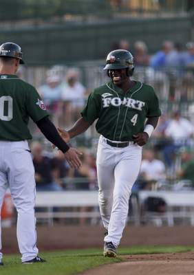 Katie Fyfe | The Journal Gazette The TinCaps' Lee Solomon rounds third after hitting a home run in the second inning Thursday against Dayton at Parkview Field. Solomon also delivered a key hit in Fort Wayne's four-run sixth.