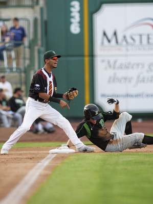 Katie Fyfe   The Journal Gazette  Dayton Dragons' Michael Siani slides into third base during the third inning against the TinCaps at Parkview Field on Friday.