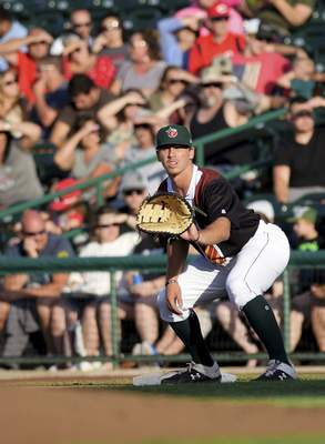 Katie Fyfe   The Journal Gazette  TinCaps' Michael Curry prepares to catch the ball at first base during the second inning against the Dayton Dragons at Parkview Field on Friday.