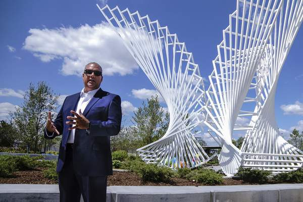 Parks and Recreation director Steve McDaniel welcomes members of the media to a sneak peek of Promenade Park before its opening Friday. (Photos by Mike Moore | The Journal Gazette)