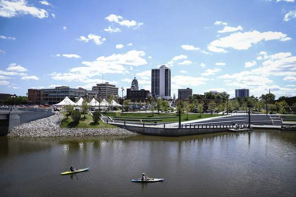 Kayakers paddle by Promenade Park on Friday as the park prepares to officially open for the weekend.