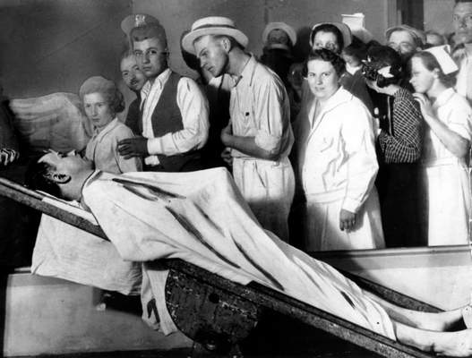 Associated Press In this July 1934 file photo, people view the body of gangster John Dillinger in a Chicago morgue.