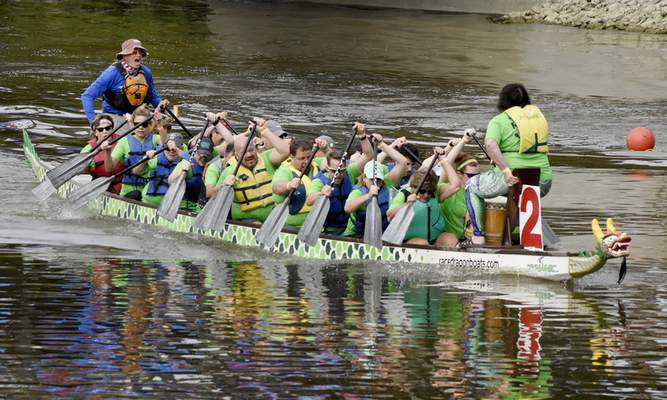 Rachel Von Stroup | The Journal Gazette  The River Rockin' Randis race to the finish during their race against the Red Hot Draggins (not pictured) during the Dragon Boat Races at Promenade Park on Saturday.