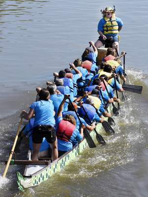 Photos by Rachel Von Stroup | The Journal Gazette The Parks Paddlers rush toward the finish line during  the Dragon Boat Races at Promenade Park on Saturday.